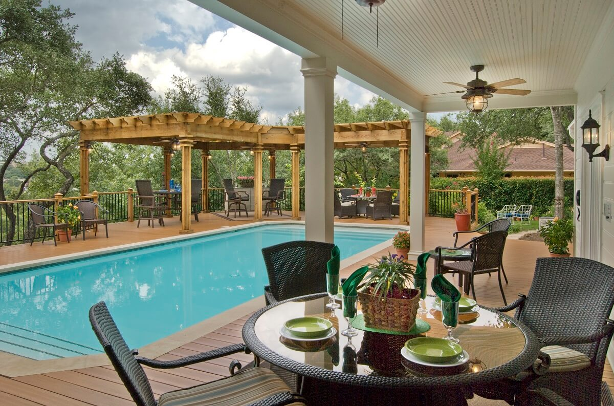 poolside deck with chairs and table
